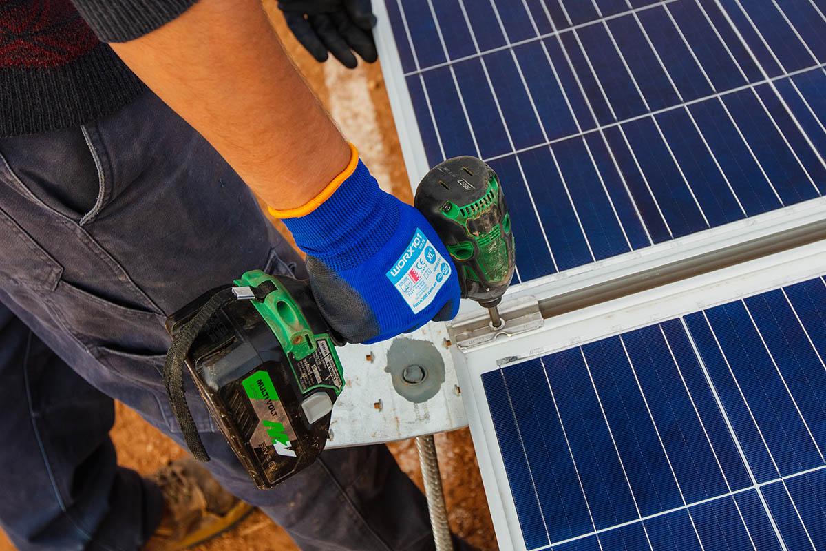 Solar power plant installation using screwdriver